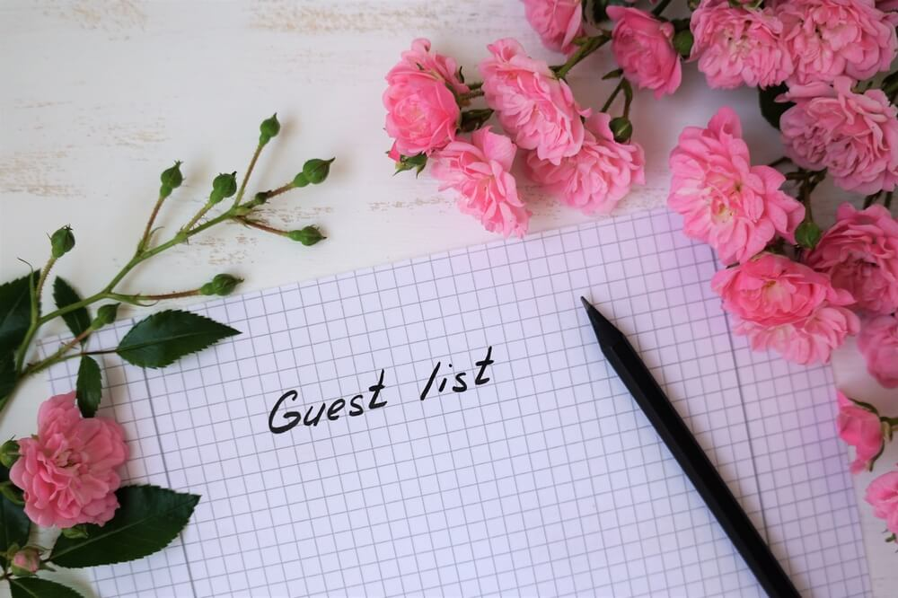 Guest list with small roses covered